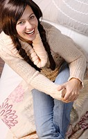 woman sitting on sofa smiling