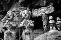 Statues of Two Smiling Tempel Dancers at the Golden Mount Temple