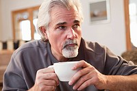 Caucasian man drinking coffee