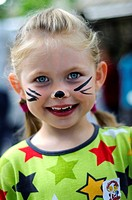 Young girl painted as a cat