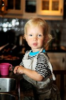 Young boy doing the dishes