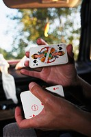 A person holding a deck of cards. Sweden