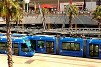 A new electric tram arrives at the tram station within the Odysseum shopping center in Montpellier, France