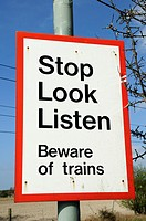 Stop Look Listen Beware of Trains Warning Sign at a Level Crossing, Harston, Cambridgeshire, England, UK