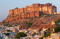 The Blue City overlooked by the hilltop Mehrangarh Fort, Jodhpur, Rajasthan, India, Asia