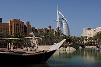 BURJ AL ARAB HOTEL AND TRADITIONAL ARAB BUILDINGS AND COUNTRY MADE SHIPS,DUBAI,UAE