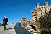 Man walking near to the castle   of Ponferrada in Castilla Le&#243;n province, Spain