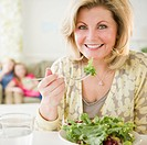 USA, Jersey City, New Jersey, woman eating salad