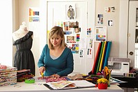 USA, Texas, Dallas, Female fashion designer working in studio
