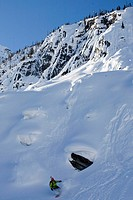 A young man splitboarding in the backcountry of Roger´s Pass, Glacier National Park, British Columbia, Canada