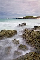 Rocky shores of Porthmeor Beach looking towards St. Ives Head, Cornwall, England, United Kingdom, Europe