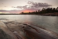 Sunset on shore of Georgian Bay at Killarney Provincial Park, Ontario, Canada.