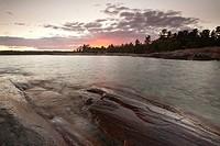 Sunset on shore of Georgian Bay at Killarney Provincial Park, Ontario, Canada.