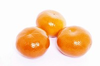 Three clementines on a white background