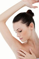 Young woman stroking her clean armpit