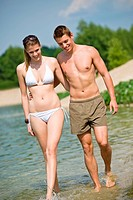 Couple in swimwear enjoy water and sun in summer