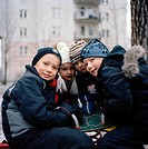 Children wearing winter clothes, Sweden.