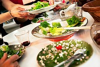 Dinner party with salad and red wine, close_up, Sweden.