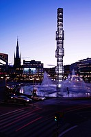 Sergels torg with fountains illuminated at dusk