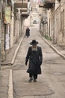 Orthodox jews walking in the Mea Sharim area of Jerusalem, Israel