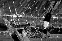 A group of teenage Nepalese practicing physical feats, in the early morning, at a circus ground, in Bangalore, India Thousands of Nepalese children an...