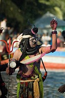 A man from the Hindu community disguised as the Hindu God Shiva, during a boat race, in Gopalganj, Bangladesh Boat race is a very popular and entertai...