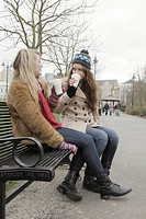 2 women in the park with take away cups