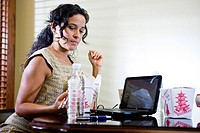 Office worker having lunch at desk