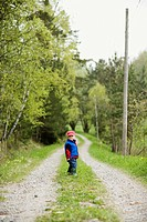 A boy on a dirt road, Sweden.