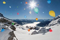 Ballons flying over winter landscape