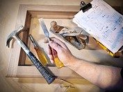Hand holding woodworking tools