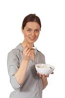woman eating muesli with yoghurt