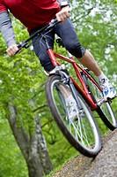 Man riding mountain bike in park