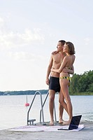 Young couple embracing on jetty