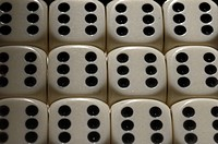 Close_up of dice in a row