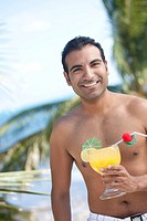 Hispanic man drinking cocktail