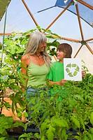 Caucasian grandmother and grandson gardening