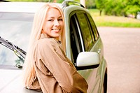 Driver_woman of car smiles