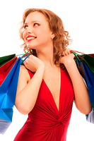 Rejoicing girl in red dress with purchases