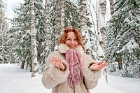 Smiling red_haired woman having fun on w