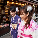 two girls walking in traditional japanese robes in teapot lane, kyoto, japan