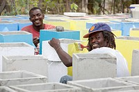 men making biosand water filters by the charity clean water for haiti, pierre payen, haiti