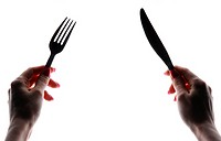Woman's hands holding knife and fork, isolated on white background