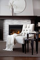 Side chair in front of fireplace