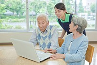 Senior people using laptop, Kanagawa Prefecture, Honshu, Japan