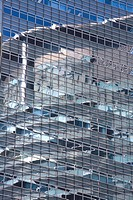Reflection of a skyscraper in an adjacent building