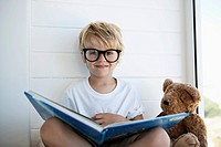 Boy sitting with picture book in lap