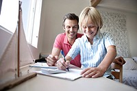 Man helping son with homework