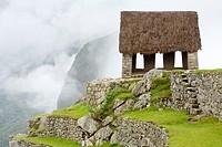 ´Watchman´s Hut´ or ´Guard House´ on a foggy morning at Machu Picchu, Peru