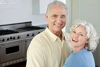 Portrait of happy couple in kitchen